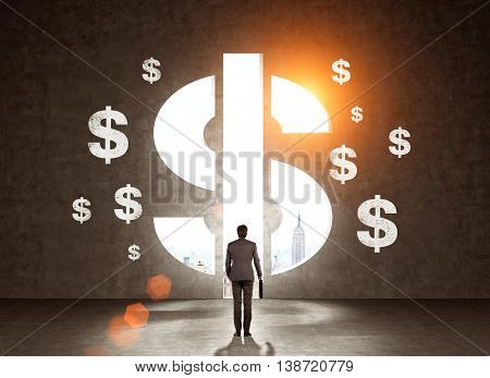 Businessman in modern suit looking at wall with dollar signs. New York at background. Toned image