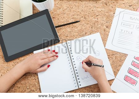 Woman Drawing In Her Notebook