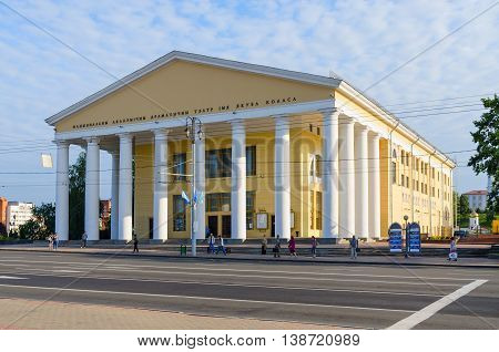 VITEBSK BELARUS - JULY 13 2016: Unidentified people stand at bus stop near National Academic Drama Theater named after Yakub Kolas Vitebsk Belarus