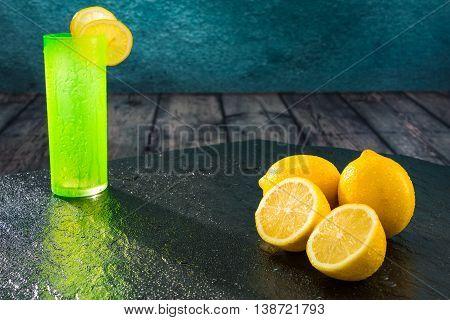 Fresh lemons freshly cut with colored glass