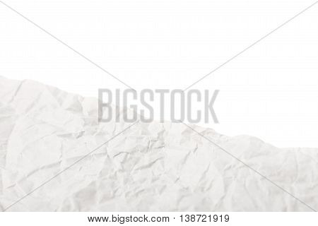 Fragment of a crumbled sheet of paper isolated over the white surface as a copyspace backdrop composition