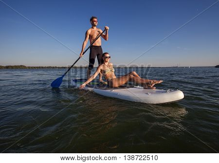 Beach Fun Couple On Stand Up Paddleboard Sup01
