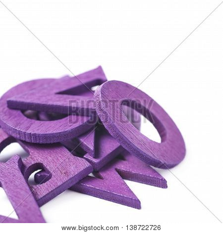 Pile of painted wooden letters isolated over the white background