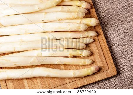 Delicate organic white asparagus ready to be peeled before they can be steamed