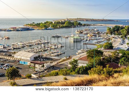 SOZOPOL - AUGUST 9: boats at sunset on August 9 2015 in Sozopol Bulgaria. boats and yachts docked near embankment in port of Bulgarian town Sozopol in evening light