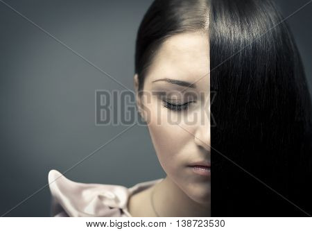 beautiful girl with the hair on dark background