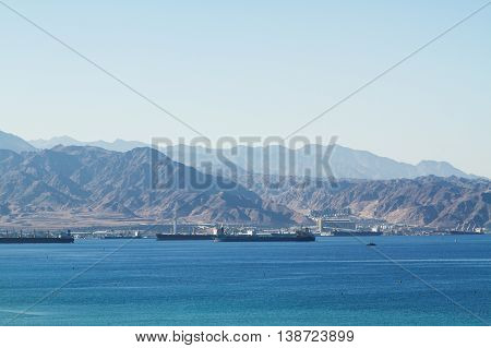 Aqaba Jordan - July 3 2016: View on the Aqaba waterfront and Aqaba sea port Jordan from the Red sea at July 3 2016 in the harbor of Aqaba Jordan