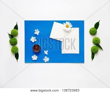 Blue Paper With Candle And Decoration Of Chrysanthemum Flowers