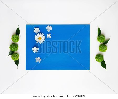 Blue Paper With Decoration Of Chrysanthemum Flowers.