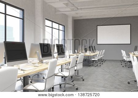 Concrete coworking office interior with blank computer monitors picture frame and city view. Mock up 3D Rendering