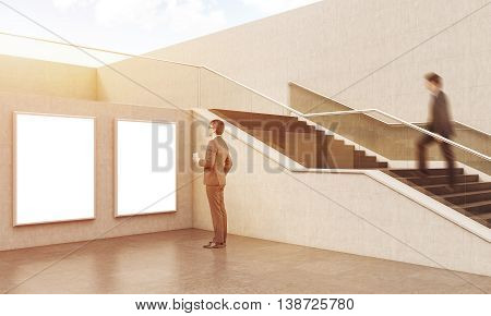 Two Businessmen Near Staircase In Building