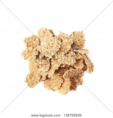 Pile of wholegrain cereal flakes isolated over the white background