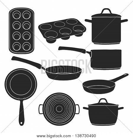 A set of silhouettes of kitchen utensils. Black silhouettes of pots, pans, baking molds. Utensils for cooking. Baking tools. Silhouettes kitchenware. Vector illustration