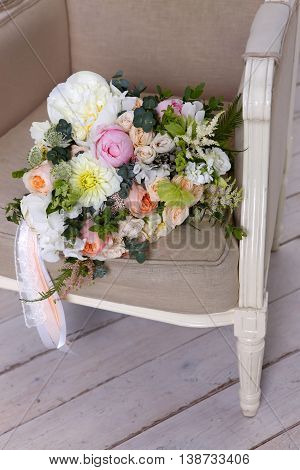 Beautiful wedding bouquet forgotten on a vintage chair