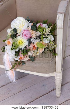 Beautiful wedding bouquet forgotten on a vintage chair