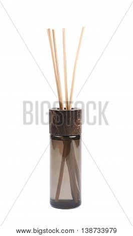Aroma wooden sticks in a dark glass vial isolated over the white background
