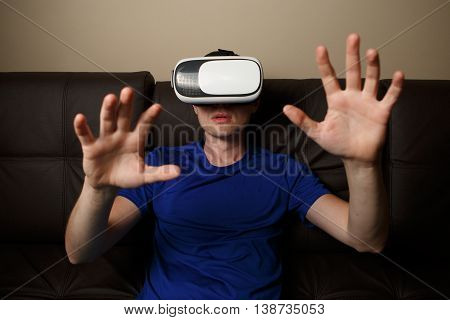 Man wearing virtual reality goggles. Vr glasses concept
