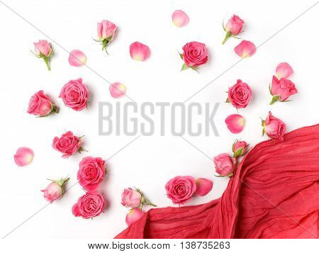 Assorted roses heads. Various soft roses and leaves scattered on a white background, overhead view. Flat lay