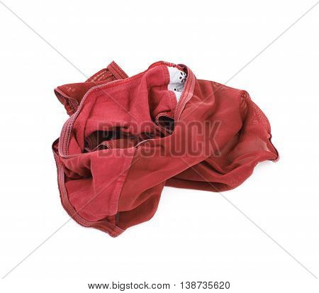 Crumpled red female panties isolated over the white background