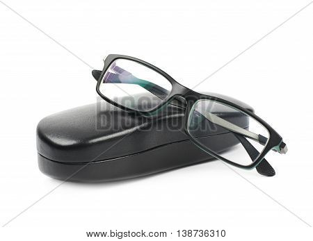 Black leather protection case box with the glasses over it, composition isolated over the white background