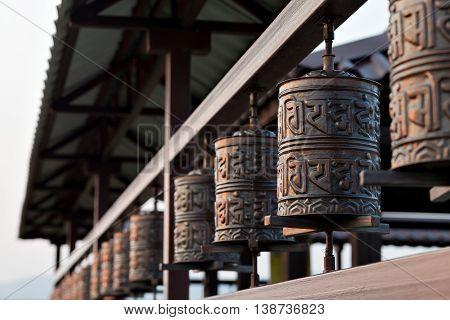 Religious prayer wheel for meditation in a Buddhist temple in Buryatia, Russia Ulan-Ude.