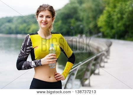 Caucasian woman tired and resting after running in city park
