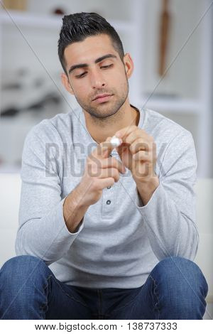 an image of a young man looking at his finger