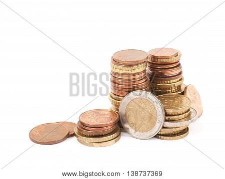 Stack pile of multiple euro coins isolated over the white background