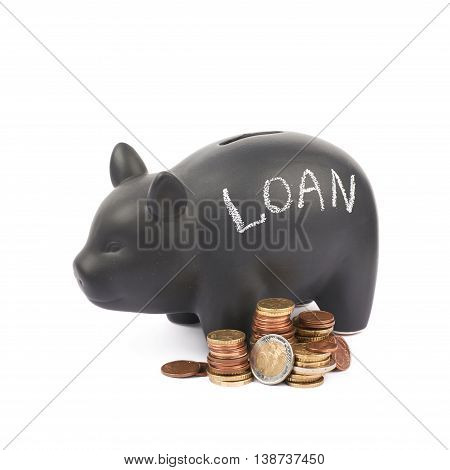 Word Loan written with chalk on a black ceramic piggy bank coin container next to a pile of euro coins, composition isolated over the white background