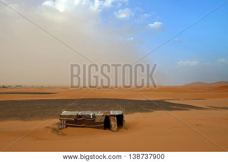 Sandy Storm and Berber tent in the Sahara, Morocco