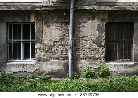 Two windows on an old concrete wall. Grunge background