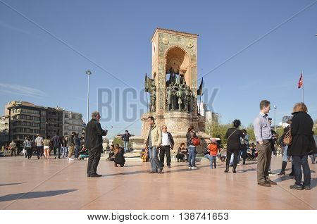 Istanbul Turkey - April 18 2014: The Republic Monument (Turkish: Cumhuriyet Aniti) is a notable monument located at Taksim Square in Istanbul Turkey to commemorate the formation of the Turkish Republic in 1923. Built in two and half years with financial s