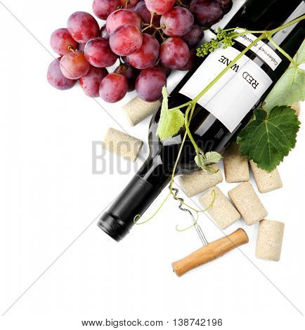 Red wine with grapes, isolated on white