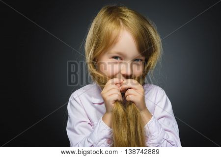 Closeup portrait shy girl isolated grey background.