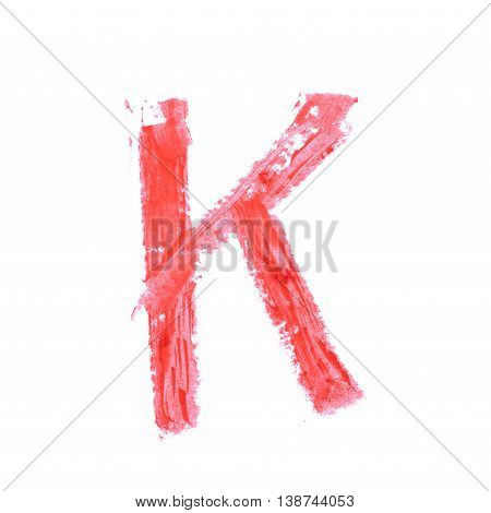 Single abc latin letter k symbol drawn with a wax crayon isolated over the white background