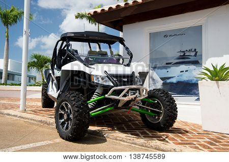 La Romana Dominican Republic-January 16 2016: big cool sport open car of arctic cat brand with wheels and hull white and green color parking sunny day outdoor near building