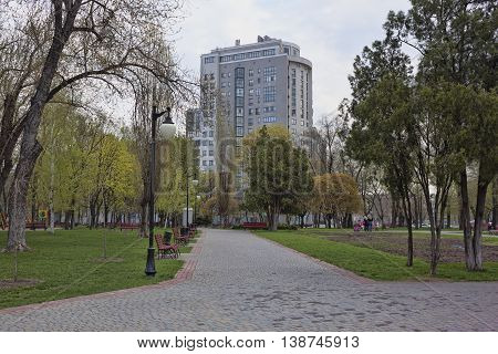 KHARKIV UKRAINE - APRIL 26 2015: On a deserted alley in a park on the waterfront in Kharkiv