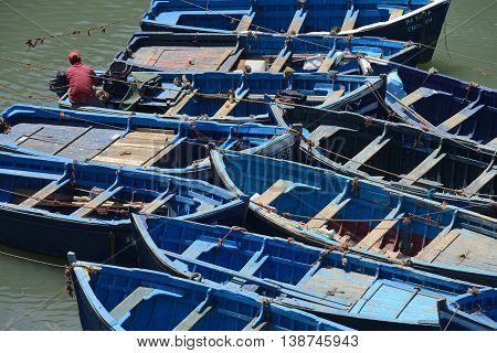 ESSAOUIRA - JULY 14: Small wooden blue fishing boats in harbor of Essaouira, Morocco, July 14, 2013. Essaouira is one of the most popular tourist place on Atlantic coast in Morocco.