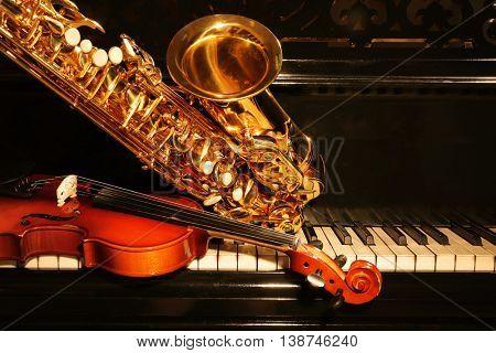 Violin with saxophone and piano, closeup