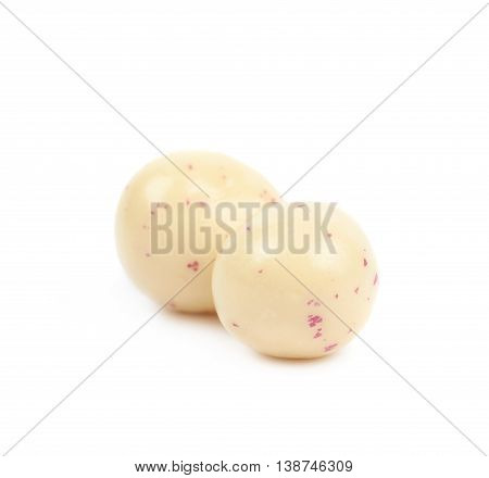 Two white chocolate candy balls isolated over the white background