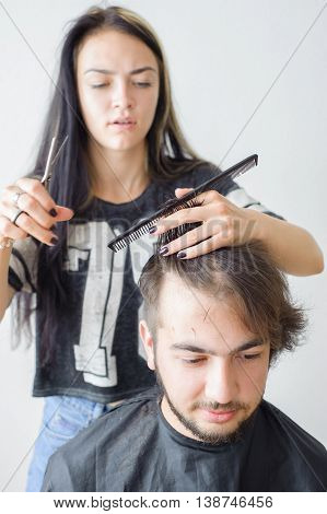 Men's Hairstyling And Haircutting In A Barber Shop Or Hair Salon.