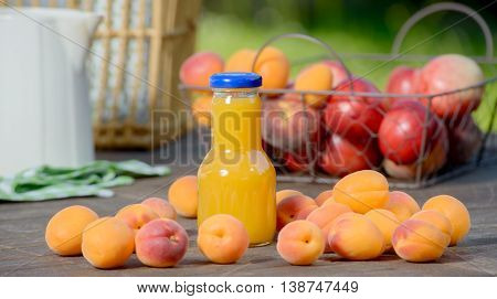 many apricots and an apricot juice drink