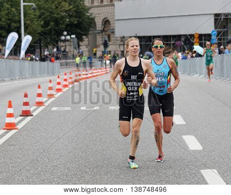 STOCKHOLM - JUL 02 2016: TCloseup of triathlete Laura Lindemann running in the Women's ITU World Triathlon series event July 02 2016 in Stockholm Sweden