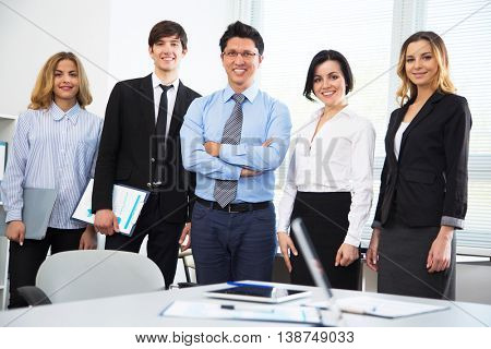 Young businessman with colleagues in modern office