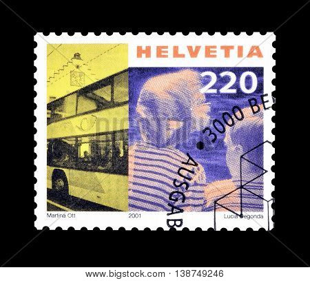 SWITZERLAND - CIRCA 2001 : Cancelled postage stamp printed by Switzerland, that shows Post omnibus and children.