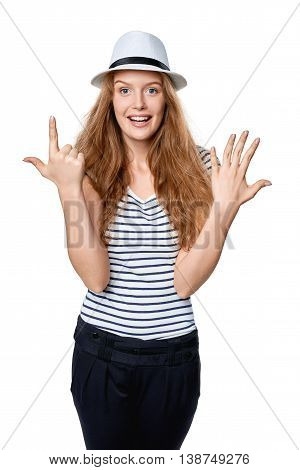 Hand counting - seven fingers. Happy excited summer woman in straw fedora hat showing seven fingers