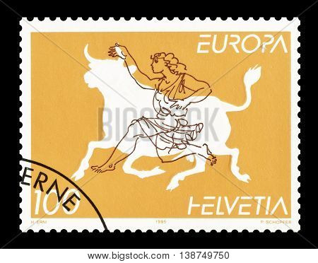 SWITZERLAND - CIRCA 1995 : Cancelled postage stamp printed by Switzerland, that shows bull and princess.