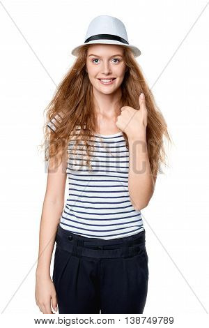 Happy excited woman with straw hat smiling at camera gesturing thumb up