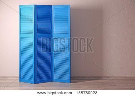 Blue folding screen in room