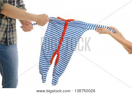 Parents dividing children clothes, isolated on white